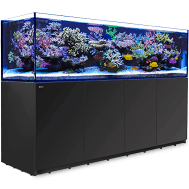 """Red Sea XXXL 900 REEFER™ Systems Rimless Reef Ready Systems for advanced hobbyists REEFER™ Concept Red Sea's REEFER™ series of Reef Systems, provide advanced hobbyists with a solid foundation forbuilding a fully featured reef or marine aquarium. The REEFER™series combines a contemporary, rimless,ultra-clear glass aquarium with a stylish cabinet and a comprehensive water management system,including a professional sump with integrated automatic top-up, and Red Sea's unique silent down-flowsystem. Incorporating technologies originally developed for Red Sea's all-in-one MAX® coral reef systems, theREEFER™ series is designed for ease of operation while enabling the advanced hobbyist to install anunlimited choice of lighting, filtration, circulation and controllers to create a uniquely customized system. Features of the Red Sea 3XL REEFER™ include: REEFER 3XL 900 – What's included: •Rimless, 19mm / ¾"""" super-clear, beveled edge glass aquarium •Elegant, reinforced plywood Marine-Spec cabinet with aluminum support •Dual side-facing return pump outlets with fittings for one or two pumps •Enlarged overflow box for increased surface skimming •Unique split sump system for unsurpassed flexibility: ◦Professional refugium-ready main sump with variable height skimmer chamber and micron filter bags and media cups ◦Extension sump (60 litres 16 gal) can be used as a dedicated frag-tank or refugium. Alternatively, it can be disconnected and used as an independent reservoir of 83 litres / 22 gal. •4 units of Reef Led 90 lighting with bespoke mounts (Deluxe models only) •A silent, regulated down-flow system with emergency overflow •Assembly-ready piping – no gluing required 3XL REEFER™ Specification REEFER™ aquariums are constructed from thick, bevelled edge, ultra-clear glass to support their elegant and modern rimless design. The aquarium sits on a recessed base that """"floats"""" it above the cabinet, which seamlessly follows the contour of the glass. The marine-spec laminated cabinet that """
